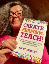 Nikky holding create, perform, teach